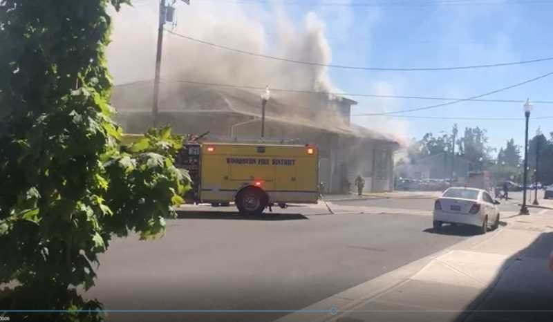 COURTESY PHOTO: WOODBURN FIRE DISTRICT - Engine 21 arriving on scene at the Aug. 16 fire in the building housing AWARE Food Bank in downtown Woodburn.