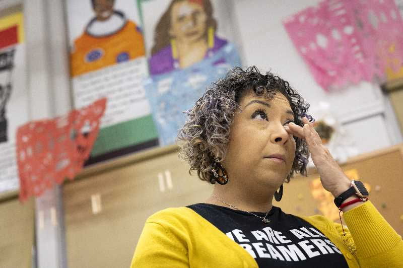 PMG PHOTO: JAIME VALDEZ - Nancy Flores Sanchez, who teaches first grade at Cesar Chavez K-8 school, holds back tears while sharing her frustration of awaiting renewal of her DACA status from U.S. Citizenship and Immigration Services.