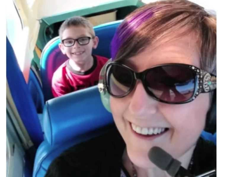 COURTESY PHOTO - Debbie Reasoner and son Jase sit in Dean Sawyer's small plane for a sightseeing flight July 8, 2019.