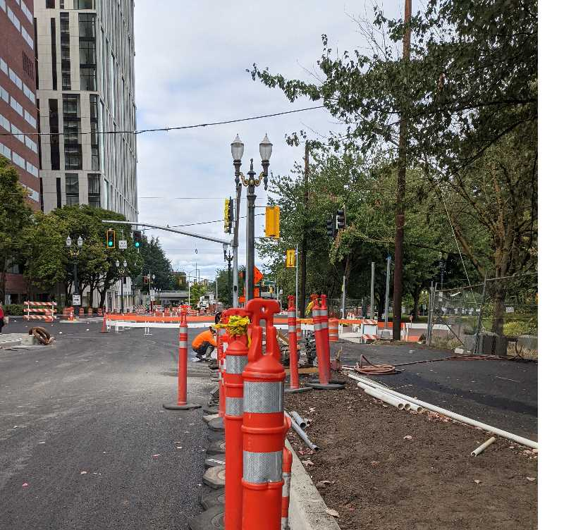 PMG PHOTO: JOSEPH GALLIVAN - The gas tax-funded SW Naito Improvement Project is expected to be done by the end of October 2021. Work includes going down to the dirt to rebuild and repave Naito, which was notoriously potholed. Shown is Naito at Clay Street on August 31, 2021. The new Multnomah County Courthouse is the white building on the left.