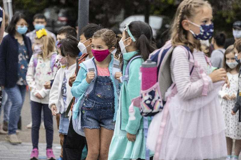 PMG PHOTO: JONATHAN HOUSE - Oak Creek Elementary School students wait to enter the building on the first day of class.