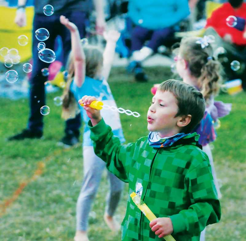 PMG PHOTO: GARY ALLEN - Kids attending the event were treated to free bubble makers and made good use of them near the stage.