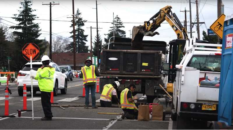 PMG FILE PHOTO - Road workers at Division Street. The job fair at Clackamas Town Center on Sept. 8 is focused on contruction and will have a strong presence by private and public constrution job hiring managers.