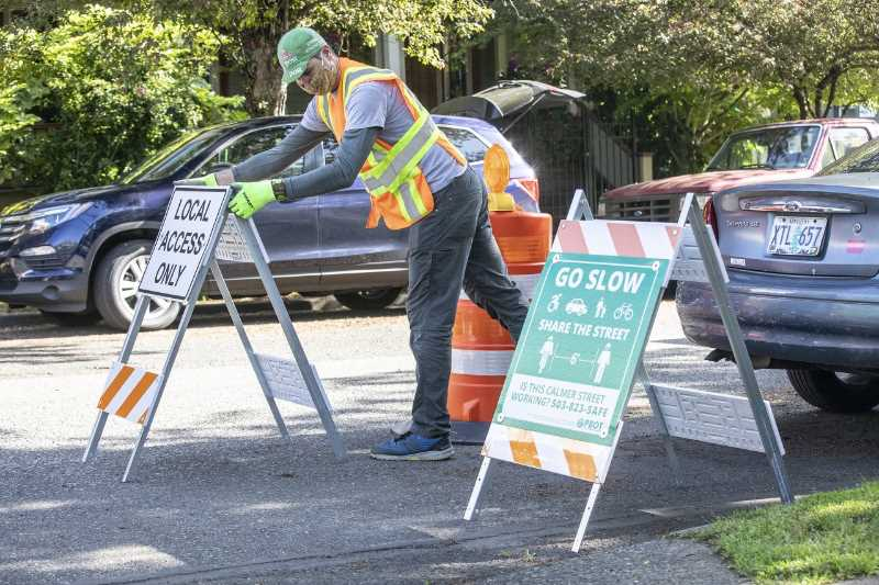 PMG PHOTO: JONATHAN HOUSE - Signs installed at intersections are intended to let drivers know 100 miles of neighborhood greenways are only open for local access.