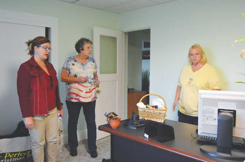 SPOTLIGHT PHOTO: NICOLE THILL - Bunker volunteers Natasha Parvey, Alta Lynch and Claudia Frace look at a newly decorated room in the Elks Veterans Bunker. Many decor items were donated by community members, including flags, picture frames and holiday decorations., South County Spotlight - News