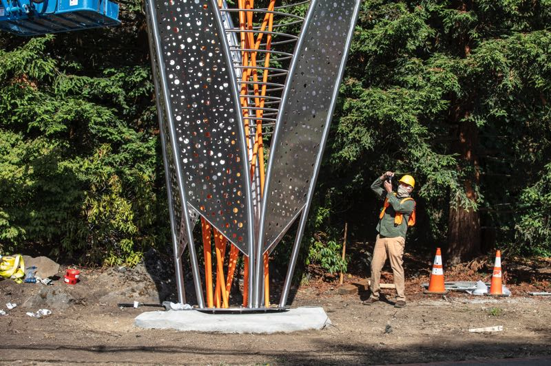 PMG PHOTO: JONATHAN HOUSE - Artist Ed Carpenter takes photos of his sculpture after it was placed along Highway 43 in Lake Oswego.