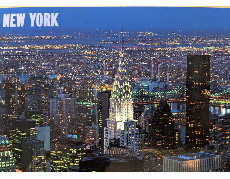 PMG PHOTO: JOSEPH GALLIVAN/IMPACT PHOTOGRAPHICS - A New York City skyline postcard from 2021 with a view of the Chrysler Building. Thew new 1 WTC is not so photogenic as what it replaced.
