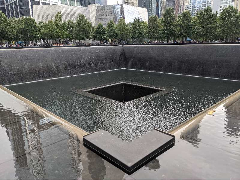 PMG PHOTO: JOSEPH GALLIVAN - The National September 11 Memorial in New York City, on the site of the old Twin Towers. Metaphor for loss or Zen water feature?