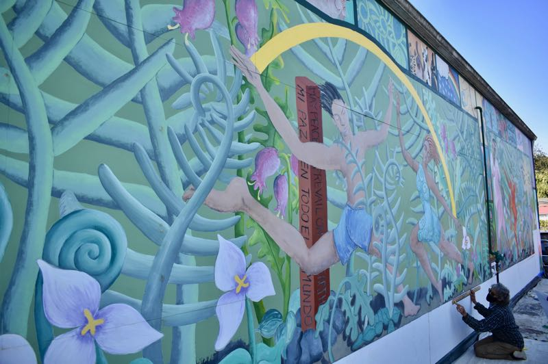 """PMG PHOTO: EMILY LINDSTRAND - For their 2021 project, Artback artists will refresh the mural """"Celebration 98,"""" located on the wall of Harmony at 221 N.W. Wade St."""