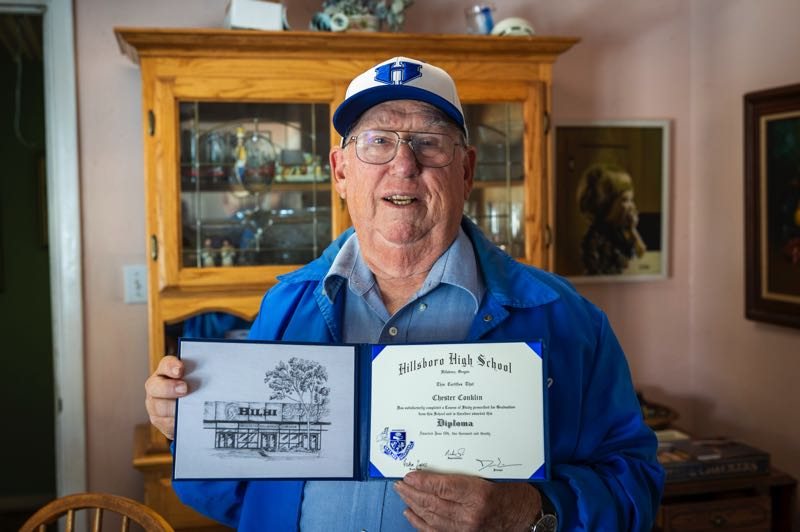 PMG PHOTO: JAIME VALDEZ - Korean War veteran Chester Conklin, 90, stands with his Hillsboro High School Class of 1949 diploma, which he recently received after asking for help from school officials.