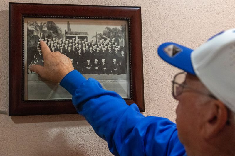 PMG PHOTO: JAIME VALDEZ - Chester Conklin points to himself in a photo taken while he served in the U.S. Navy during the Korean War.