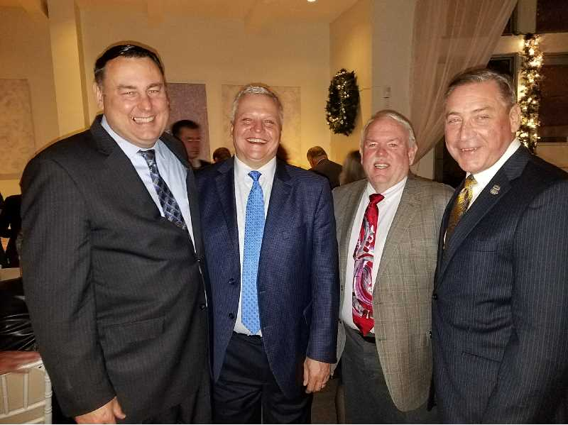 COURTESY - The 'four horsemen' who lead the public safety group in Washington DC to pass legislation creating FirstNet. From left:  Former San Jose Police Chief Chris Moore, Johnson, former APCO International President Dick Mirgon and former New York Police Department Chief Chuck Dowd.