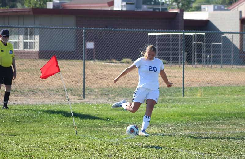 ANDY DIECKHOFF/CENTRAL OREGONIAN - Senior Emma Bales takes one of three second-half corner kicks that the Cowgirls earned against Madras.