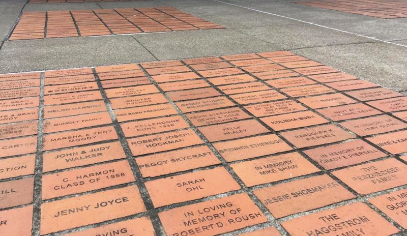 COURTESY PHOTO - Memorial bricks outside of the Estacada Public Library are for sale. Proceeds go toward the next phase of Wade Creek Park.