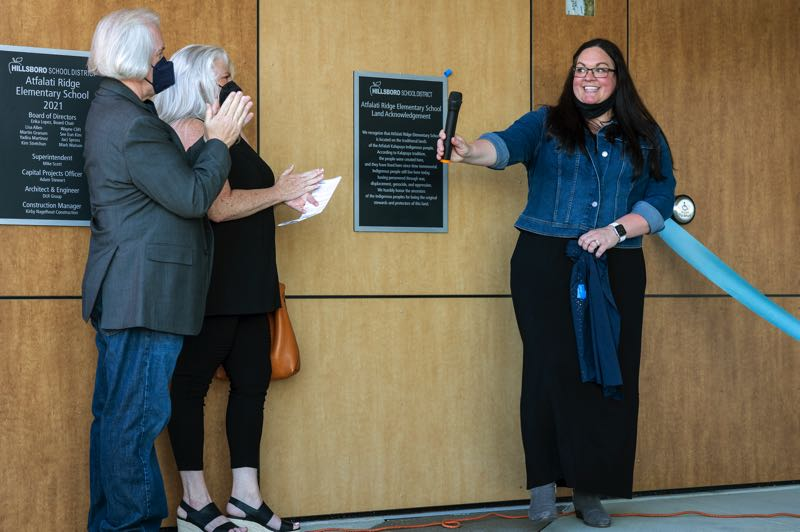 PMG PHOTO: JAIME VALDEZ - Left to right, Mark Watson, Hillsboro School District board chair, former board member Jaci Spross and Dani Johnson, principal of Atfalati Ridge Elementary School, dedicate a plaque with a land acknowledgement to the new school.