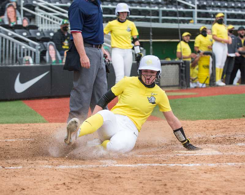 COURTESY PHOTO: OREGON ATHLETIC COMMUNICATIONS  - Hannah Galey slides into home for the winning run in an April 23, 2021 game against Stanford.