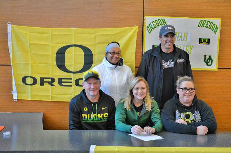 PMG PHOTO: JAMES MCNEAL - Hannah Galey, center, surrounded by her father Wayne, coach CiJay Koler, club hitting coach Dennis Muir, and mother Tina, announces her decision to attend and play softball for the University of Oregon in November 2017.