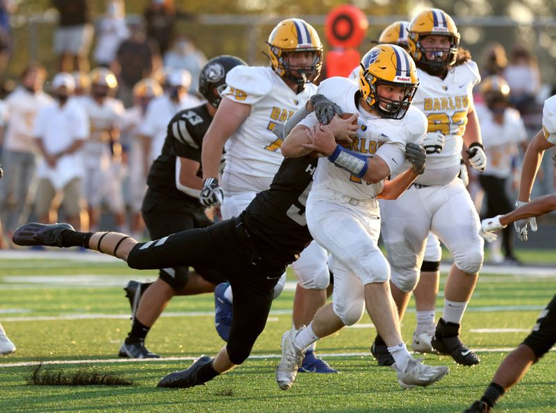 PMG PHOTO: JONATHAN HOUSE - Barlow's Hunter MacDonald carries the ball in the Bruins' 41-0 season-opening win on Friday, Sept. 3 at Nelson High.