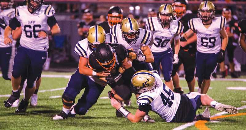 COURTESY PHOTO: SARAH OLIVER - The Canby defense played a good game against an offense that schools don't often see in the Dallas Dragon's wing-T.