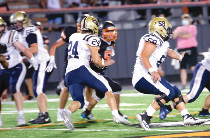 COURTESY PHOTO: SARAH OLIVER - Running back Tyler Konold (24) cuts off the block of lineman Colin Kennedy (58) for a good gain Friday against Dallas.