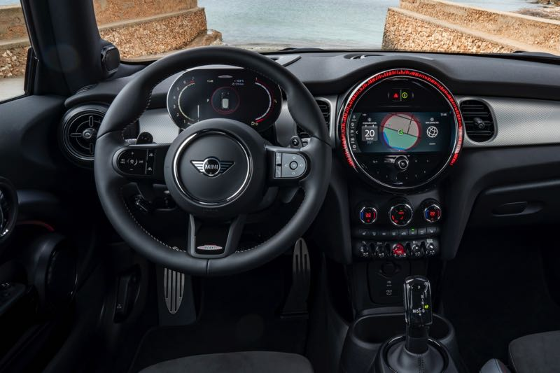 COURTESY PHOTO: BMW - The MINI dash designs are a mix of retro elements and modern tech, like the contrast between the toggle swithces and the electronic automatic transmission shifter. The huge dial on the dash original housed the speedometer. Now it is the display screen.