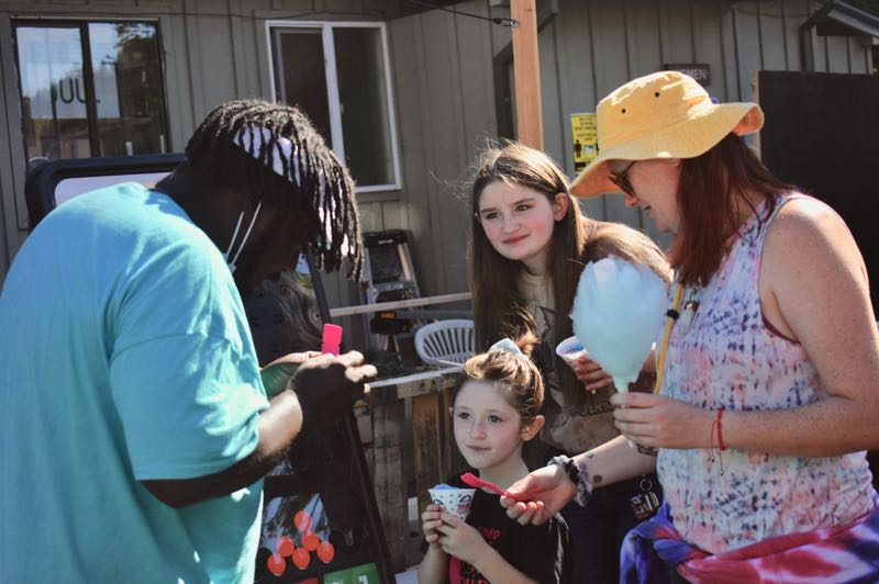 PMG PHOTO: EMILY LINDSTRAND - Community members gather around one of the games at the appreciation event at Promontory Park on Sunday, Sept. 5.