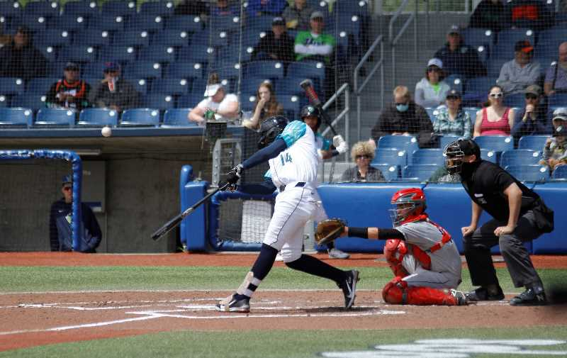 PMG FILE PHOTO: WADE EVANSON - Hillsboro's Axel Andueza takes a cut during a Hops game earlier this season. Andueza batted .500 during five games against Eugene last week.