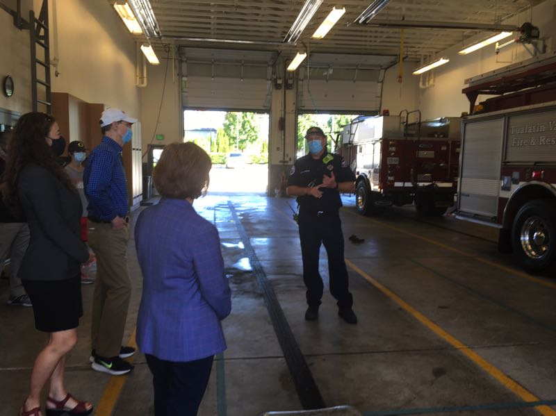 PMG PHOTO: PETER WONG - State Rep. Dacia Grayber, from left, U.S. Sen. Ron Wyden and U.S. Rep. Suzanne Bonamici hear Lt. Nick Zarfas explain the trucks and engines used by Tualatin Valley Fire & Rescue at its Oak Hills station north of Beaverton. Grayber is a TVF&R firefighter and paramedic. Wyden and Bonamici visited the station on Monday, Sept. 6, as a thank-you to firefighters on Labor Day.