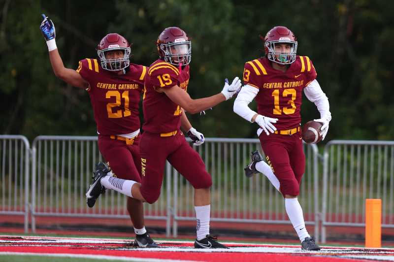 PMG PHOTO: JAIME VALDEZ - Central Catholic's Stryder Todd-Fields (13) celebrates a touchdown after a kickoff return against Camas at Pioneer Memorial Stadium.