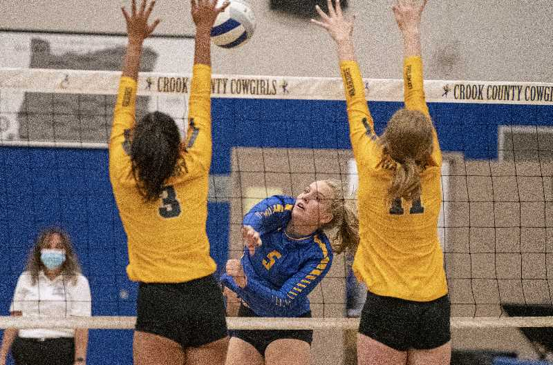 LON AUSTIN - Josie Kasberger smacks a kill shot during the Cowgirls' win over Philomath Thursday in Prineville. The short-handed Cowgirls got by Philomath in three sets but fell to Sisters in three on Saturday.