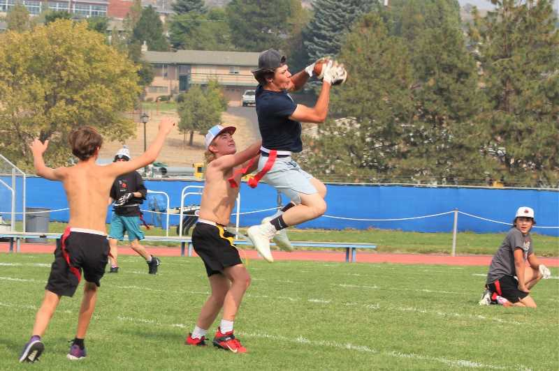 ANDY DIECKHOFF/MADRAS PIONEER - After filling up on barbecue chicken, the team broke out into a game of flag football.