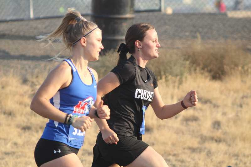ANDY DIECKHOFF/MADRAS PIONEER` - Culver sophomore Olivia Rydman, right, has been the fastest finisher on the girls' side in both races so far.