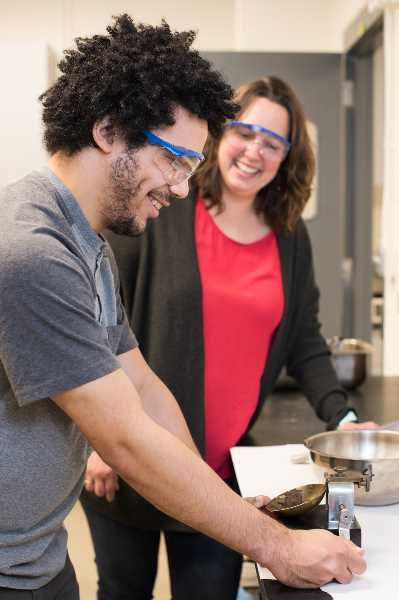 COURTESY PHOTO: PORTLAND COMMUNITY COLLEGE - Instructor Tara Nelson supervises student Zachary McKay during a civil and mechanical engineering materials testing lab pre-pandemic.