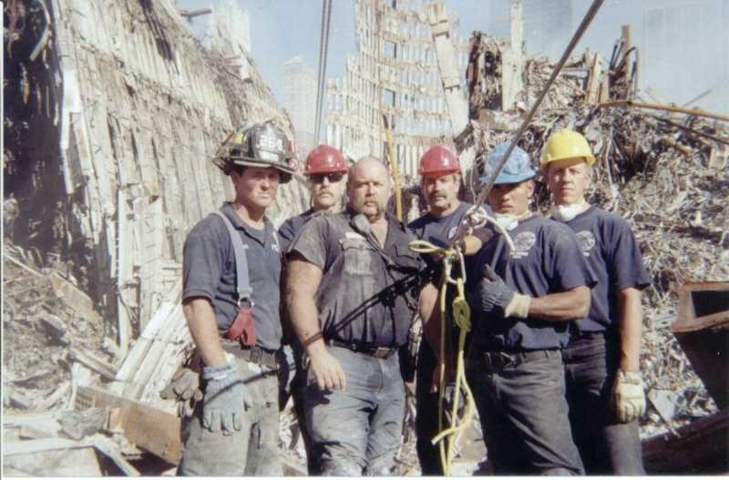 COURTESY PHOTO: NEIL MARTIN - The firefighters at Ground Zero in the days following the 9/11 attacks are: Mike Peacock (FDNY), Wes Loucks (PF&R), Billy Quick (FDNY), Dwight Englert (PF&R), Neil?Martin?(PF&R) and Ed Hall (PF&R)