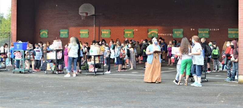 PMG PHOTO: CINDY FAMA - Students and staff gather under the covered area at Colton Elementary School at the start of the first day of school, Tuesday, Sept. 7.