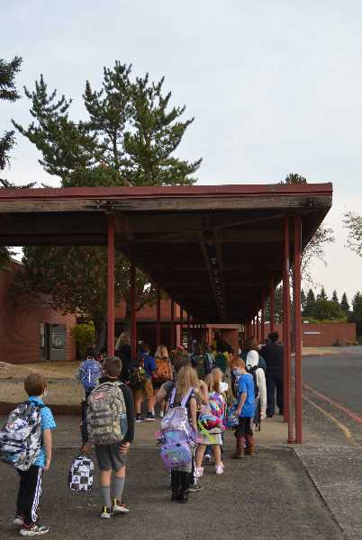 PMG PHOTO: CINDY FAMA - Colton Elementary School students head into the building for their first day of the new school year.