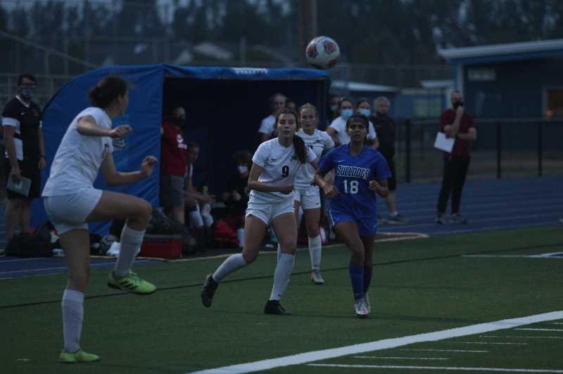 PMG PHOTO: TANNER RUSS - Woodburns Thalia Monroy battles for position against a visiting Crescent Valley player.