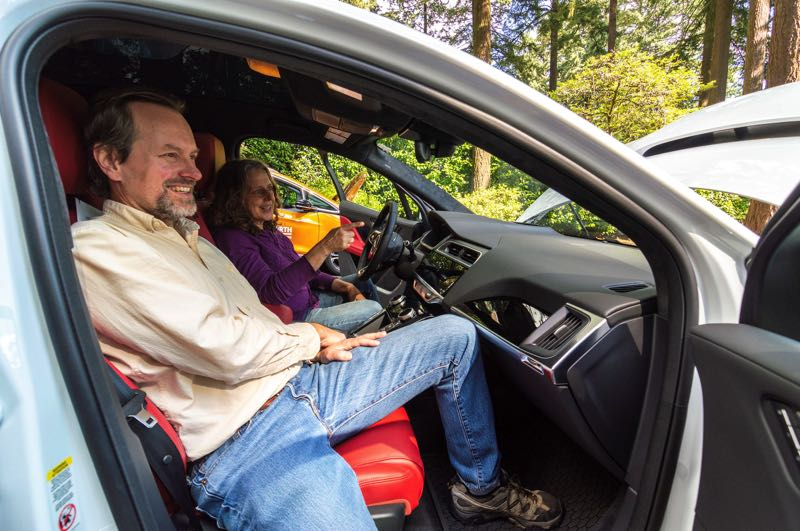 PMG FILE PHOTO - Mark Callicotte and Christy Clark check out the electric vehicles at Lake Oswego's 2019 EV Fair. The next fair will be Oct. 2.