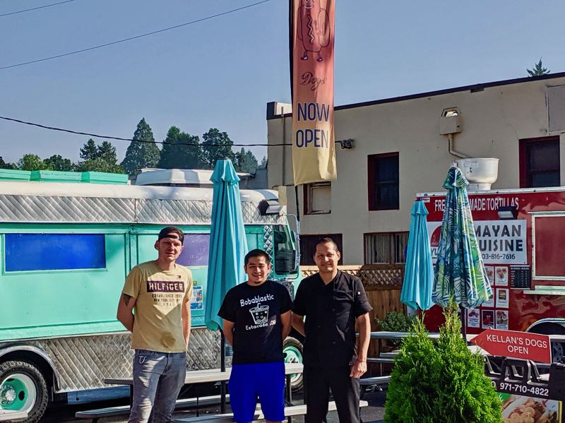 PMG PHOTO: EMILY LINDSTRAND - Kellan's Dogs co-owner Richard Schjoth, Bobablastic co-owner Gilmer Gongora and Kellan's Dogs co-owner Juan Luna are looking forward to welcoming community members to a grand opening event for the Lumber Yard food cart pod.