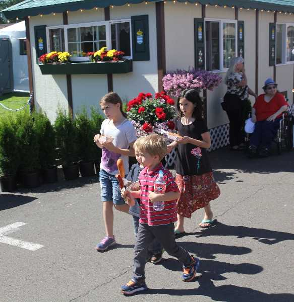 PMG PHOTO: JUSTIN MUCH - The food is always a popular draw at the Oktoberfest in Mount Angel., Woodburn Independent - News