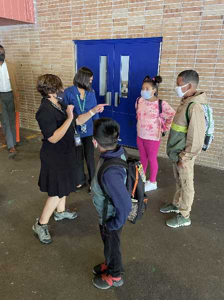 COURTESY PHOTO: REYNOLDS SCHOOL DISTRICT - Reynolds Superintendent of Schools Danna Diaz learning names of students at Glenfair Elementary.