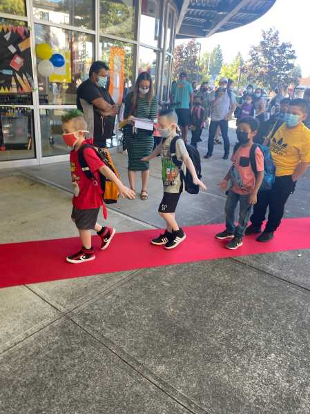 FOREST GROVE SCHOOL DISTRICT - Elementary school students in Cornelius enter on the red carpet on the first day of school Wednesday.