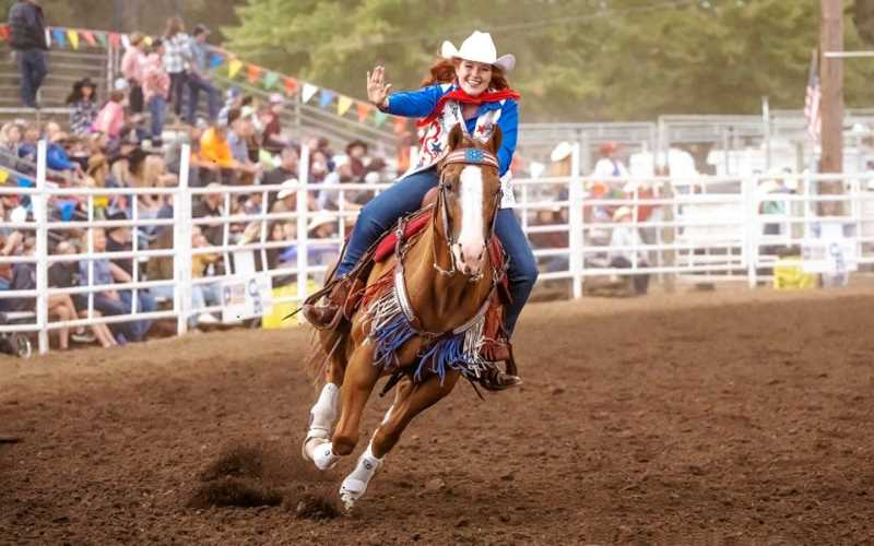 COURTESY PHOTO: JEFF WONG - Avalon Irwin rides her way to the crown during the Clackamas County Fair and Canby Rodeo in August.