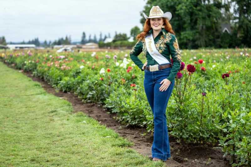 COURTESY PHOTO: JEFF WONG - Miss Rodeo Oregon 2022, Avalon Irwin, poses for photos at Canby's famous Swan Island Dahlias.