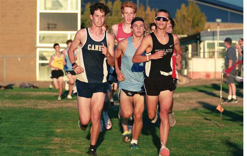 PMG PHOTO: MILES VANCE - Canby's Maddox Oliver battles a small group of runners at the TRL Preview meet at Oregon City Wednesday afternoon.