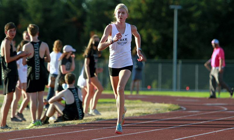 PMG PHOTO: MILES VANCE - Lake Oswego freshman Ana Peters races down the home stretch to win the Three Rivers League Preview meet at Oregon City High School on Wednesday, Sept. 8.