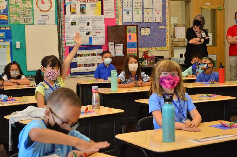 PMG PHOTO: RAY PITZ - Sophie, a second-grader in Cheri Gamaches class at Alberta Rider Elementary School, asks a question during the first day of school Wednesday.