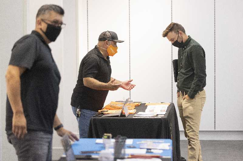 PMG PHOTO: JONATHAN HOUSE - A jobseeker at the job fair in the former The Children's Place at Clackamas Town Center. The fair was the first of four each Wednesday in September and was focused on construction trades. Employers are keen to hire both skilled and unskilled workers.