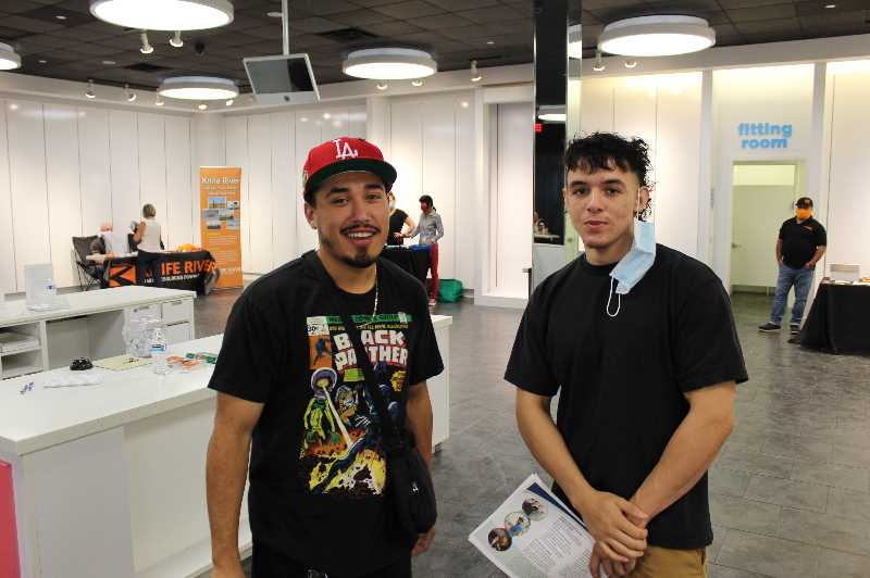 PMG PHOTO: JOSEPH GALLIVAN - Fresh high school grads Jorge Meza (left) and Christopher Dominguez-Ford were looking for drywall hanging and taping work. (They agreed to lower their masks briefly for the photograph.)