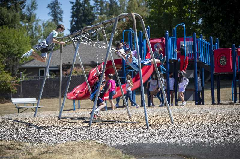 PMG PHOTO: JAIME VALDEZ - Students at Bridgeport Elementary School play on the playground during a recess during the first day of school.